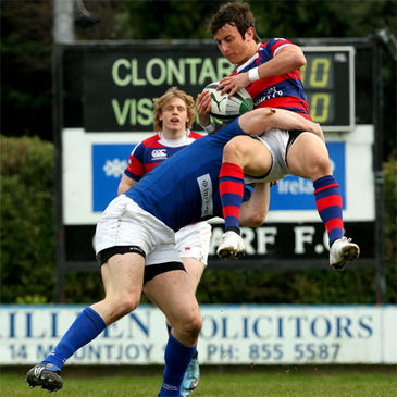 St. Mary's College winger Ronan Doherty tackles Clontarf's Hugo Nolan