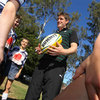 Ronan O'Gara takes time out from signing autographs to pass on some tips to these rugby-playing youngsters