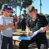 Ireland out-half Ronan O'Gara signs a young fan's book as the players soak up the atmosphere and the fine weather
