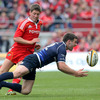 Ronan O'Gara closes in on Leinster centre Fergus McFadden, with the two sides battling for every scrap of possession