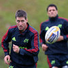 Ronan O'Gara follows the flight of the ball during the province's rain-hit training session in Bishopstown