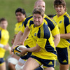 Ronan O'Gara spreads the ball wide during Munster's squad session at UL on Wednesday
