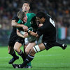 Ireland number 10 Ronan O'Gara is caught in possession by New Zealand's Dan Carter and Jerome Kaino