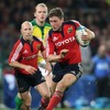 Munster out-half Ronan O'Gara has Peter Stringer in support as he bursts forward at Thomond Park