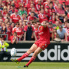 Ronan O'Gara is pictured aiming his conversion attempt towards the posts. The Corkman captained Munster, with Paul O'Connell on the bench