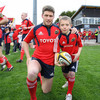 Munster's captain for the night Ronan O'Gara poses with mascot Harry O'Riordan prior to kick-off