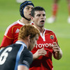 Glasgow flanker Rob Harley and Munster's Niall Ronan and Denis Leamy wait for a lineout throw