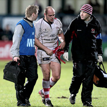 An injured Rory Best heads for the touchline