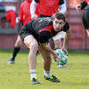 Springbok star Ruan Pienaar passes the ball away from a ruck during Tuesday's training session in Belfast