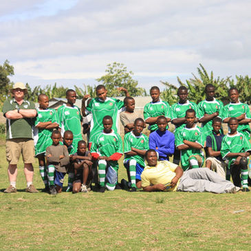 Naas clubman David Mckeown with some of the Tanzanian kids
