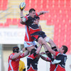 Second row Ryan Caldwell takes down a lineout ball one-handed, under pressure from the Scarlets