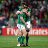 Donnacha Ryan commiserates with fellow forward Cian Healy as Ireland's four-match winning streak at the World Cup is ended by Wales
