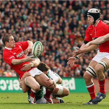 Wales' Shane Williams and Ryan Jones in action against Ireland