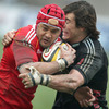 Former New Zealand centre Sam Tuitupou keeps a tight hold of the ball as he is tackled by Aironi's Matteo Pratichetti