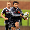 New Zealander Sam Tuitupou, another of Munster's summer recruits, gets his pass away during Tuesday's training stint
