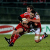 Munster full-back Scott Deasy is caught in possession by Ulster's try scorer Thomas Anderson