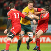 Australia's Scott Higginbotham tries to find a way past Munster winger Denis Hurley and hooker Damien Varley