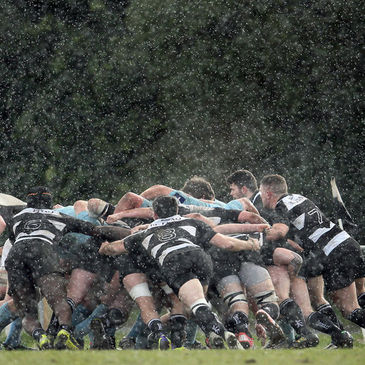 A view of a scrum during a rain shower at Anglesea Road