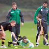 Sean Cronin and Rob Kearney watch as Jordan Roylance, aged 11, from St Pius X School gets over for a try