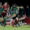 Connacht hooker Sean Cronin gets his legs pumping as he looks to break away from Munster's Dave Ryan and Ronan O'Gara