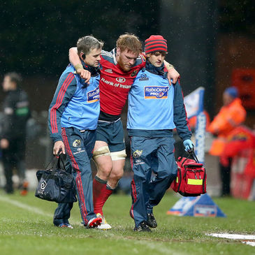 Sean Dougall is helped off the Thomond Park pitch