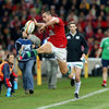 Scotland's Sean Maitland, one of the Lions' try scorers in the first half, stretches to try and keep a bouncing ball in play