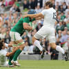 France full-back Cédric Heymans tries to bring down the onrushing Sean O'Brien during the opening minutes of Saturday's game