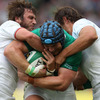 Try-scoring flanker Sean O'Brien is sandwiched by France's Maxime Médard and Cédric Heymans during the first half