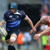Paul O'Connell reaches out for Sean O'Brien as the Leinster flanker puts boot to ball near the right touchline