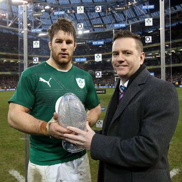 Sean O'Brien receives his award from Jude McElroy