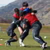 Jonathan Sexton, Conor Murray and Rob Kearney are shown taking part in a training exercise during Sunday's session in Queenstown