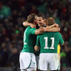Jonathan Sexton, who kicked nine of Ireland's 15 points, is pictured celebrating with fellow backs Andrew Trimble and Keith Earls