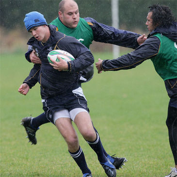 Jonathan Sexton is tackled by CJ van der Linde and Isa Nacewa