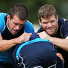 Shane Jennings, who captained Leinster against the Scarlets, and Gordon D'Arcy are pictured getting stuck in during a training drill