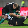 Ireland replacement flanker Shane Jennings keeps a tight hold of the ball as he is tackled by New Zealand's Jimmy Cowan and Owen Franks
