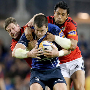 Shane Jennings is tackled by Ronan O'Gara and Casey Laulala