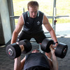 Stephen Ferris spots for his back row colleague Shane Jennings during today's weights session for the Ireland players