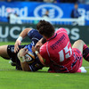 Leinster's stand-in captain Shane Jennings wrestles his way over the try-line, despite the best efforts of Cardiff full-back Chris Czekaj