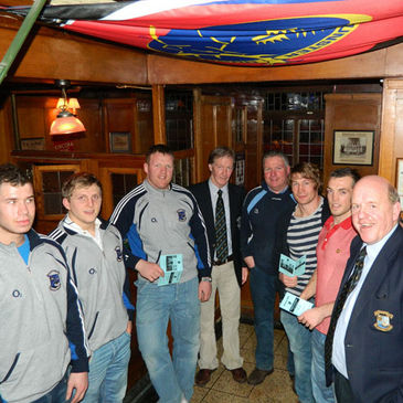 Eddie Price, Jerry Flannery and Ian Dowling with members of the Shannon senior squad