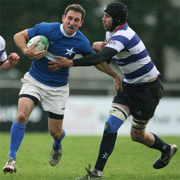 Shaun McCarthy takes the ball on for St. Mary's College