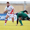 Aironi lock Marco Bortolami tries to regain his footing as Ulster's Scottish winger Simon Danielli charges forward