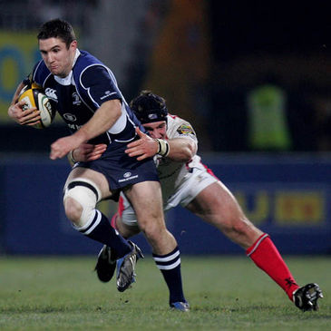 Leinster winger Simon Keogh is tackled by Ulster's David Pollock