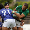 Ireland Under-20 winger Simon Zebo tries to shrug off a challenge from Samoa's Fred Tuua