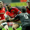 Munster winger Simon Zebo is tackled by the Ospreys' Kahn Fotuali'i and Andrew Bishop during the round 5 tie in Swansea