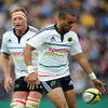 Munster winger Simon Zebo puts boot to ball as Mick O'Driscoll, who played against Scotland last weekend, looks on