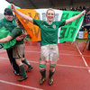 Siobhan 'Flaming' Fleming holds the Irish flag aloft as the post-match celebrations get underway in Parabiago