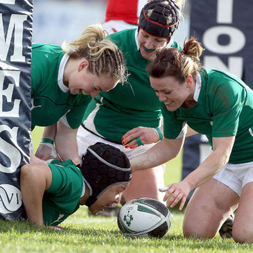 Try scorer Sophie Spence is congratulated by her team-mates