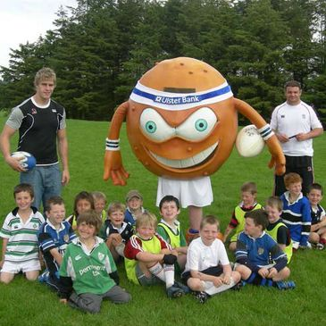 Andrew Trimble, Spud and Jarlath Carey with the CAI kids