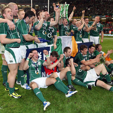 The Ireland players celebrate with the trophies