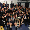 Members of Leinster's matchday squad and the extended panel squeeze in for a dressing room shot with the Heineken Cup trophy